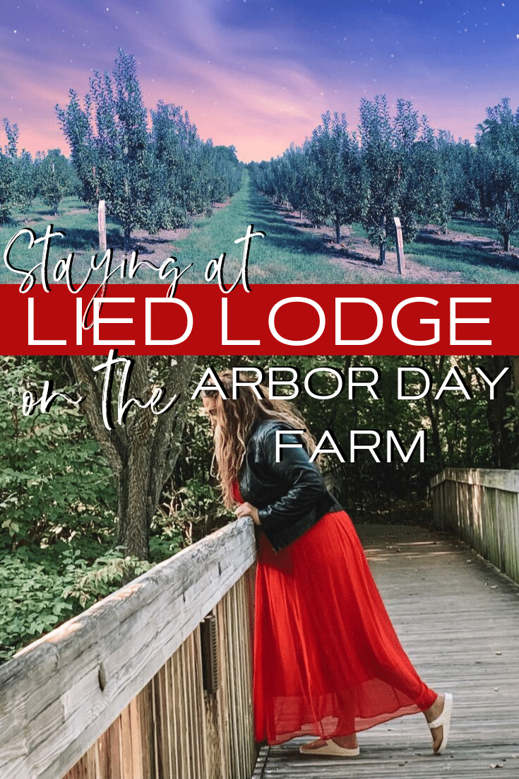 Stay at Arbor Day Farms' Lied Lodge | Lied Lodge | Arbor Day Foundation | Arbor Day Lodge | Nebraska City, Nebraska | Where to stay in Nebraska City | Apple picking Arbor Day Farms | family road trip | Midwest road trip | best places to see fall leaves | Red dress | travel blogger | Kathy Haan