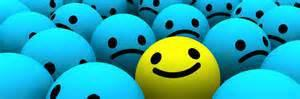 there are lots of blue balls with frowny faces and one yellow ball with a happy face