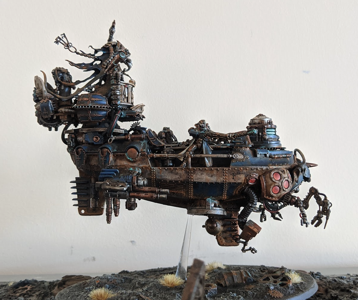 A floating airship built from an Age of Sigmar kit with many arms and parts added from Ad mech and other sources