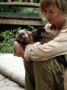 Volunteer and a monkey at the refuge