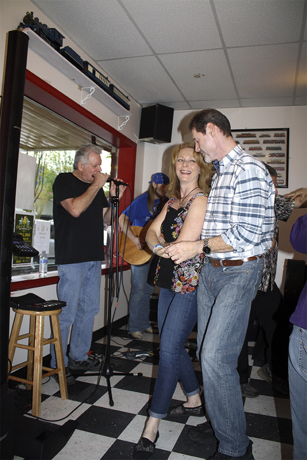 A couple dances to the sound of Paul Green, left, and Seth Freeman at Twede's Cafe, Saturday evening, April 26, during the second annual North Bend Blues Walk. - Seth Truscott/Staff Photo