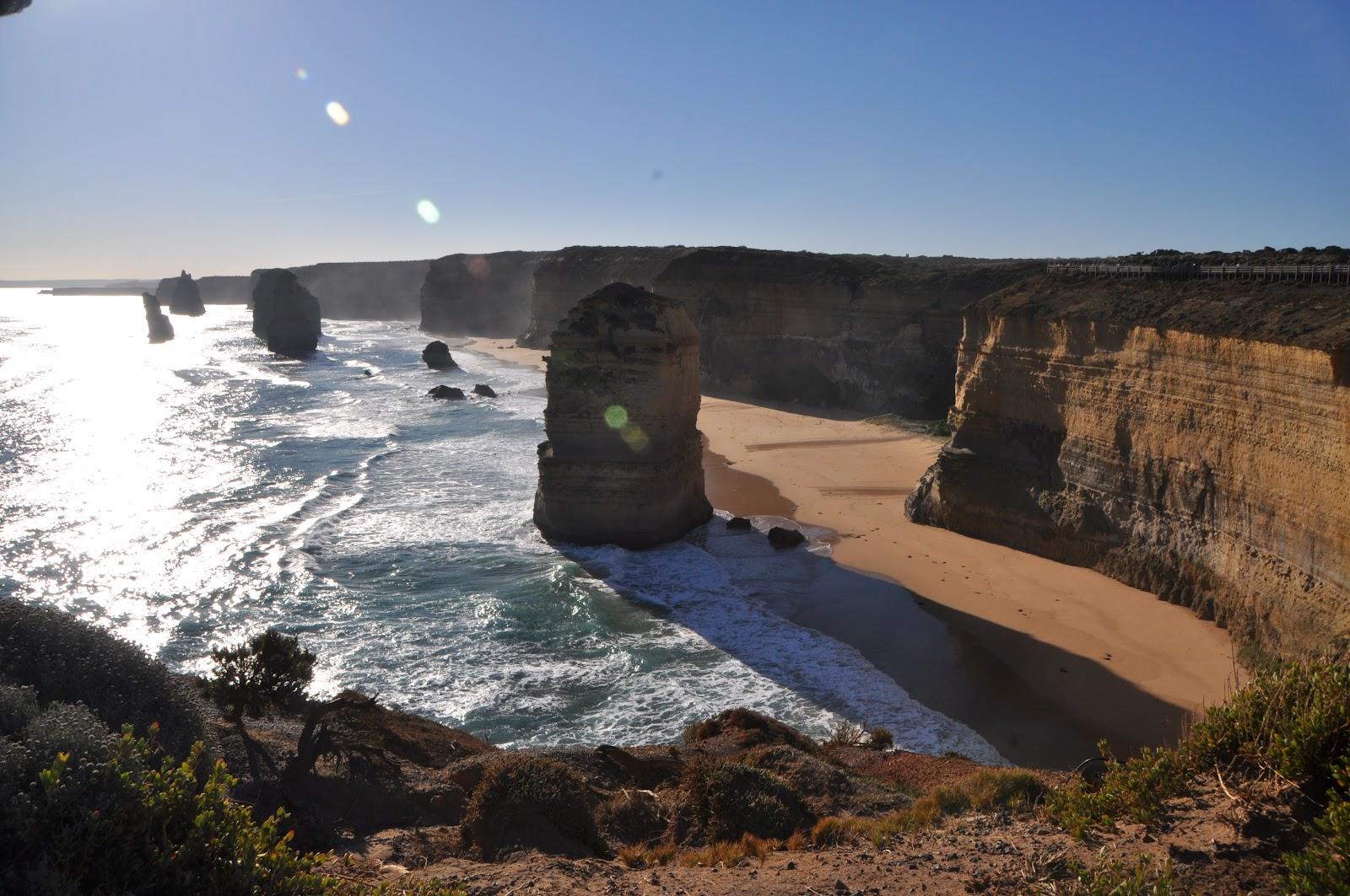 twelve apostles limestone cliffs near ocean coast small waves on a clear summer day in australia
