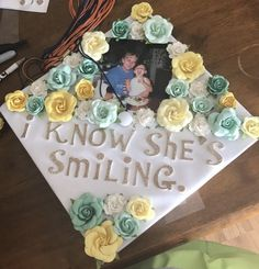 """A graduation cap that reads """"I know she's smiling."""""""