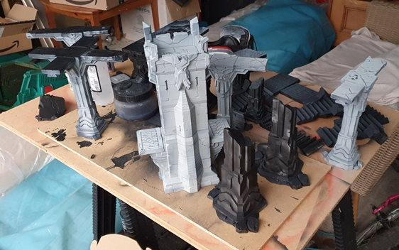 3D printed plastic towers, pillars and walkways, in various shades of black and grey after airbrushing.
