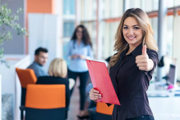 https://media.istockphoto.com/photos/portrait-of-young-business-woman-at-modern-startup-office-interior-picture-id804153878?k=20&m=804153878&s=612x612&w=0&h=elboQZDfSRaZ2brY7ct92AeMr2IBhteIYeE0bFQFPWE=