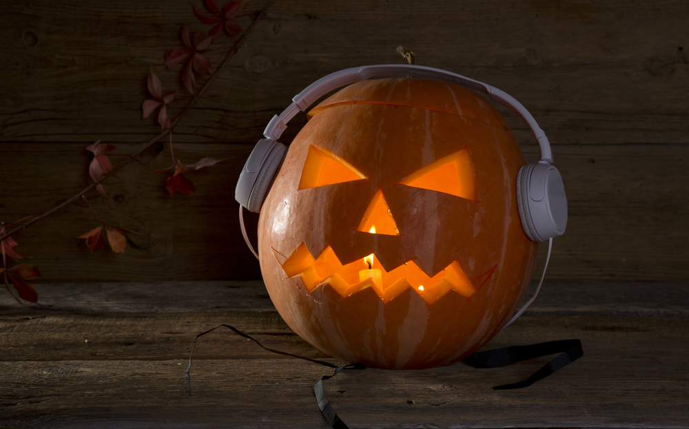 a jack o'lantern sporting a pair of headphones