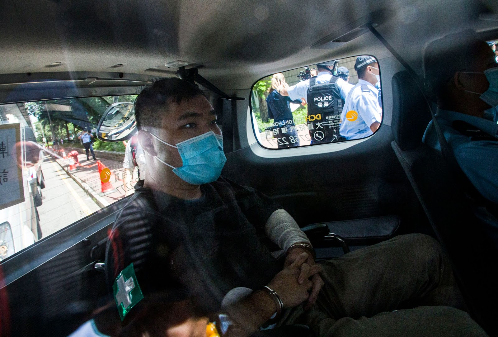 """Defendant Tong Ying-Kit, 24, arrives at court after being accused of deliberately driving his motorcycle into a group of police officers on July 6, 2020 in Hong Kong. Tong is the first person to be charged for """"incitement to secession"""" and """"terrorist activities"""" under the Hong Kong National Security Law."""