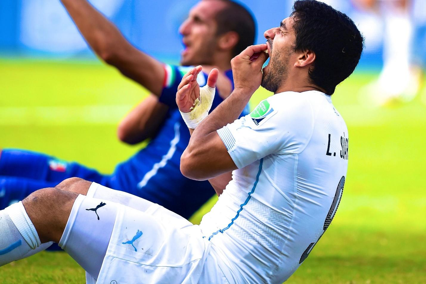 Luis Suarez Banned 9 Matches for Biting Giorgio Chiellini During 2014 World  Cup | Bleacher Report | Latest News, Videos and Highlights