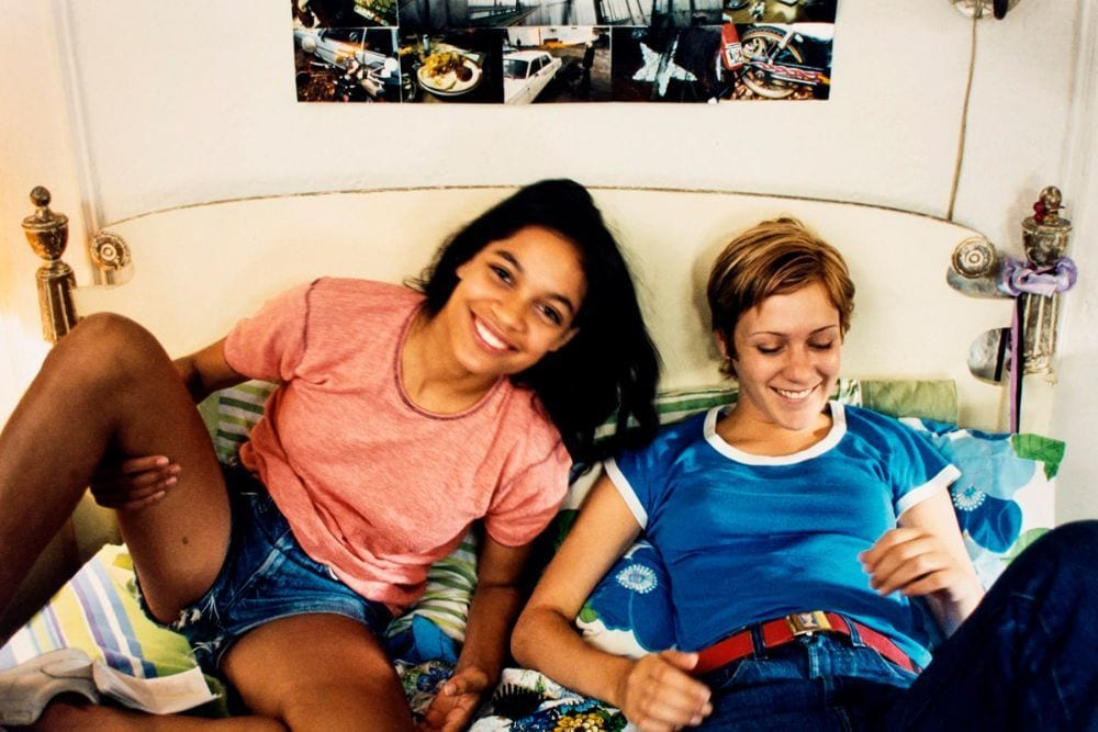 Ruby and Jennie smiling on a bed in Larry Clark's Kids