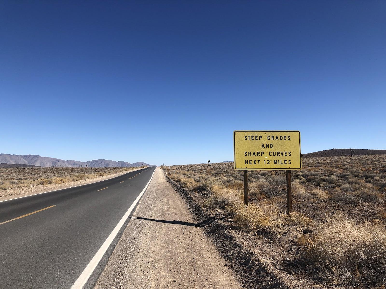 Biking Panamint Grade - steep grade sign, road and mountains