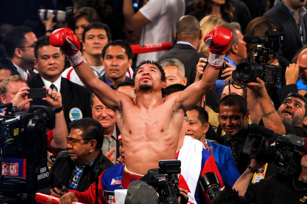 Manny Pacquiao raising his hands after a fight, Manny Pacquiao's next fight