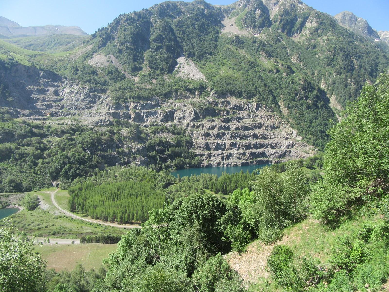 bicycle climb Col du Glandon - Lac de Grand Maison, quarry, mountainside