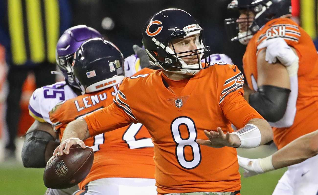 Tyler Bray of the Chicago Bears readies to throw as the Vikings charge at him.
