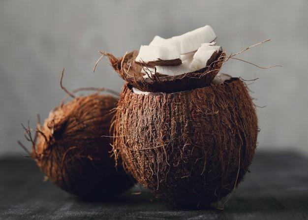 Coconut slices over coconut. tropical fruit Free Photo