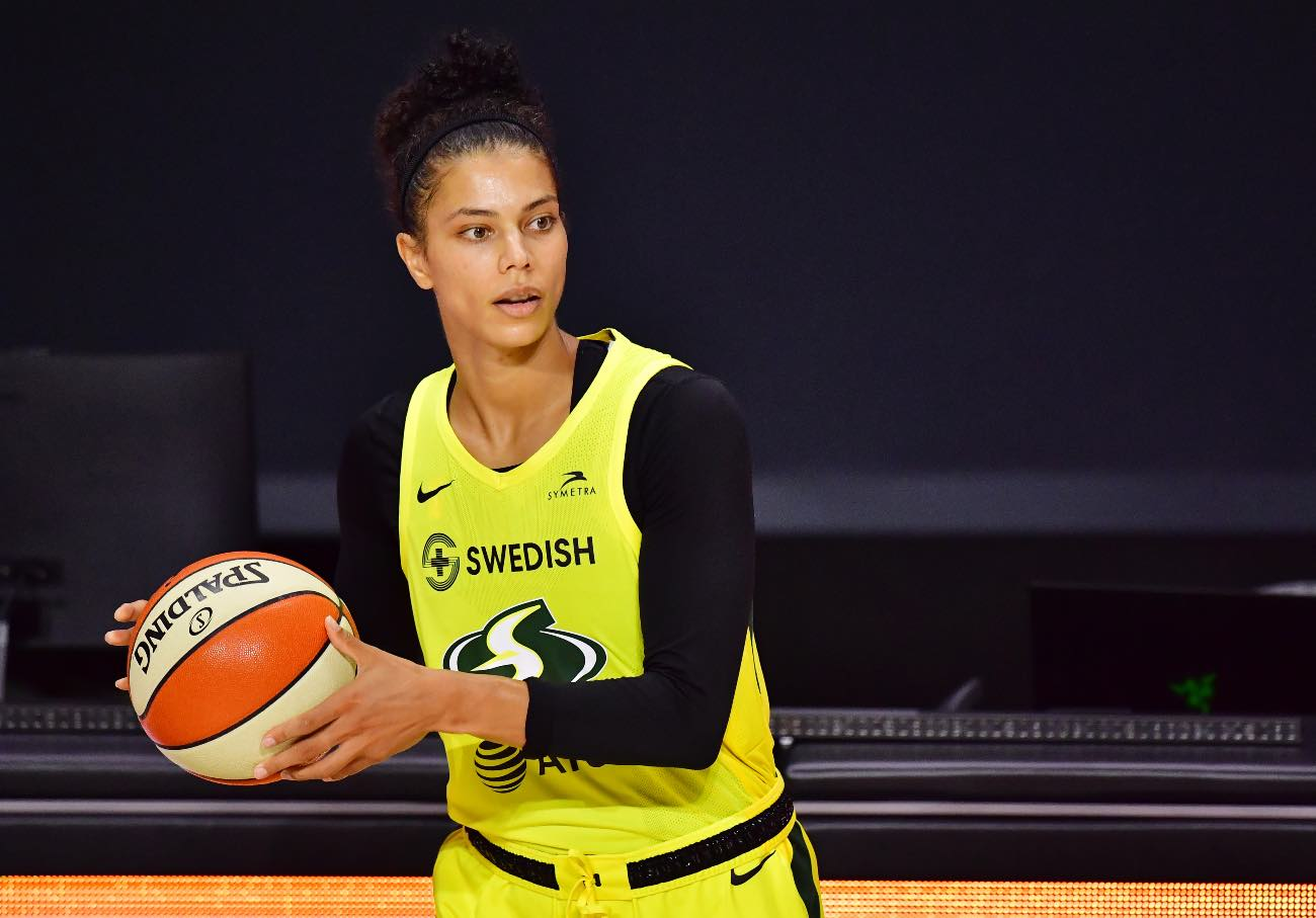 PALMETTO, FLORIDA - SEPTEMBER 27: Alysha Clark #32 of the Seattle Storm looks to inbound the ball during the second half of Game Three of their Third Round playoff against the Minnesota Lynx at Feld Entertainment Center on September 27, 2020 in Palmetto, Florida. (Photo by Julio Aguilar/Getty Images)