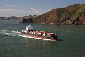 Ocean freight full of containers approaching the port.