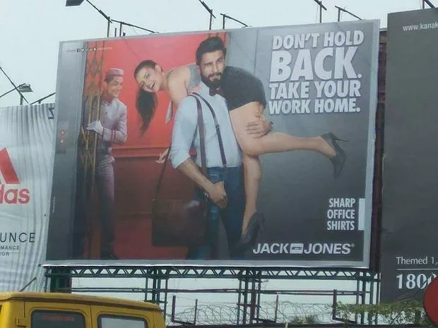 A billboard with a person on it  Description automatically generated with low confidence