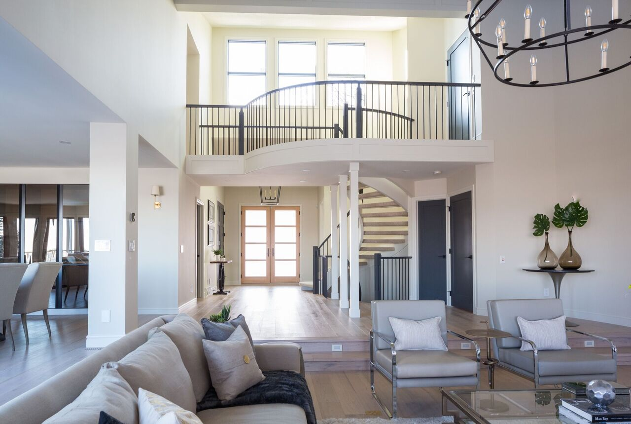 NW Calgary beautiful staircase and landing upstairs, floor to ceiling windows Leanne Bunnell Interiors