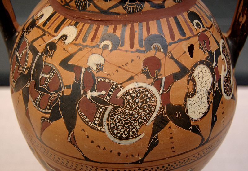 Greek hoplites facing each other in battle painted on a clay vessel.