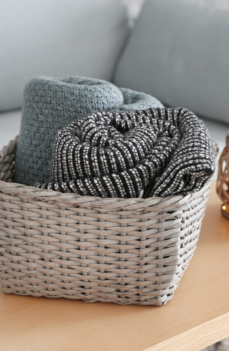 It can be tricky figuring out how to store and organize blankets, but these tips and tricks should help. Using baskets to display and store your blankets is always a good idea!