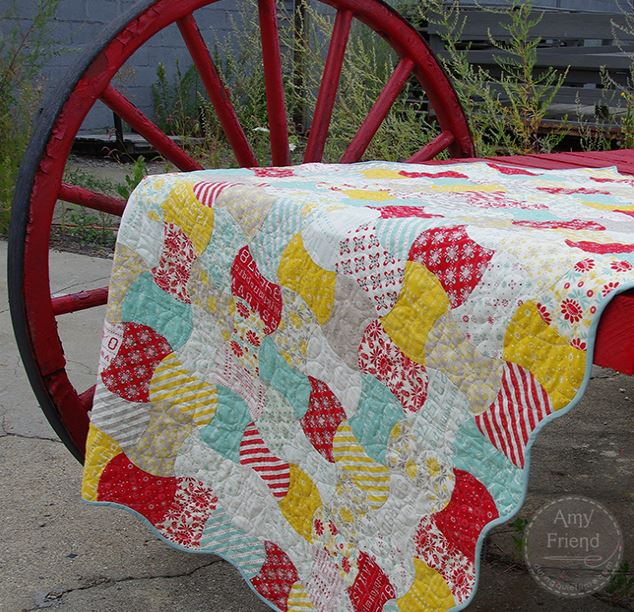Colorful Quilt Hanging Over Red Wagon
