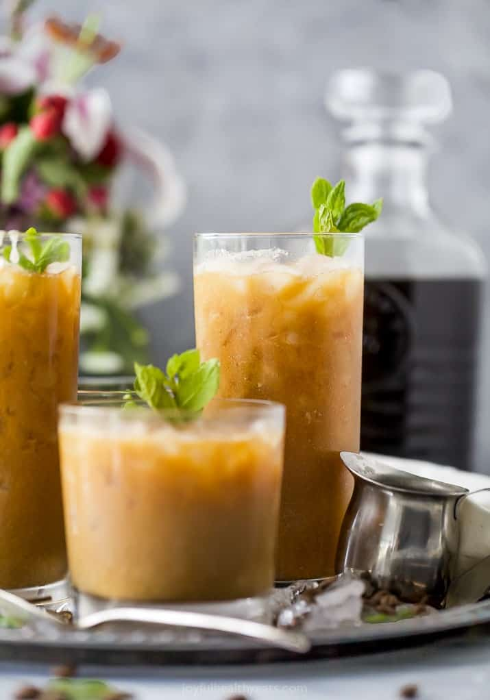 Short & tall glasses with coconut milk Thai iced coffee on tray