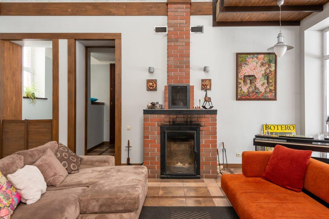 Brick fireplace near couches in apartment