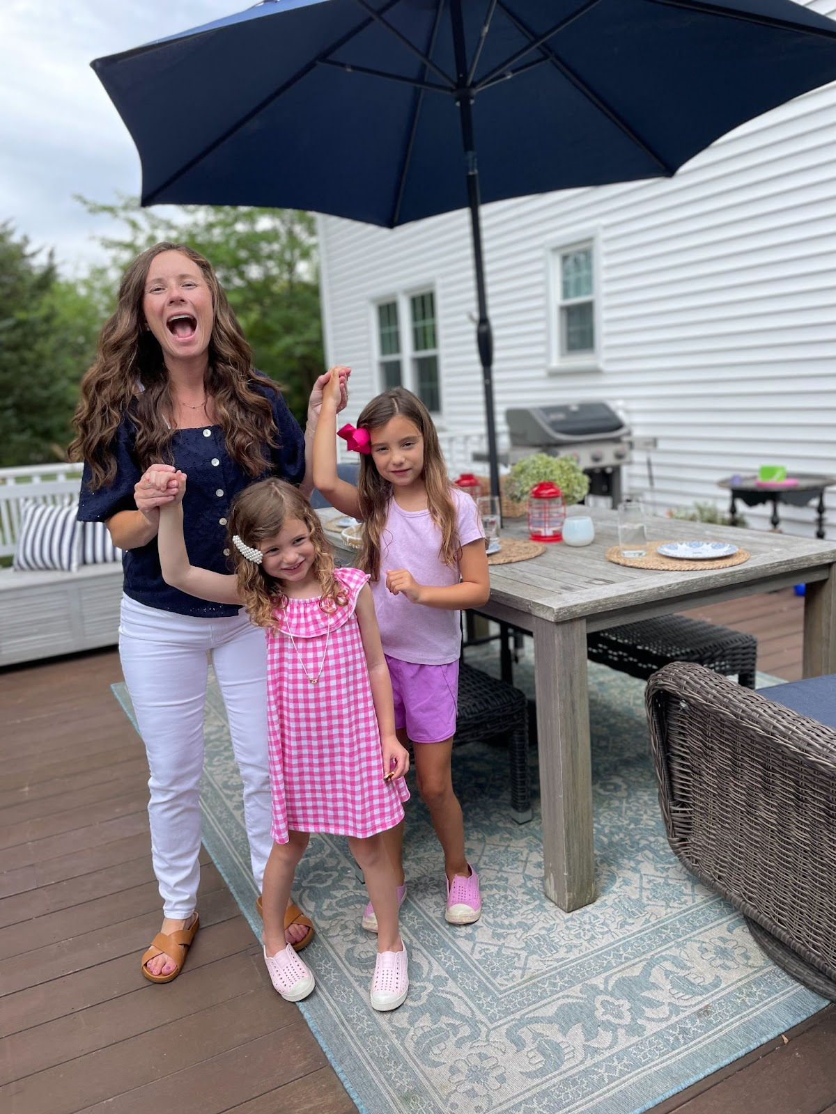 Mom celebrating with daughters to go back to school