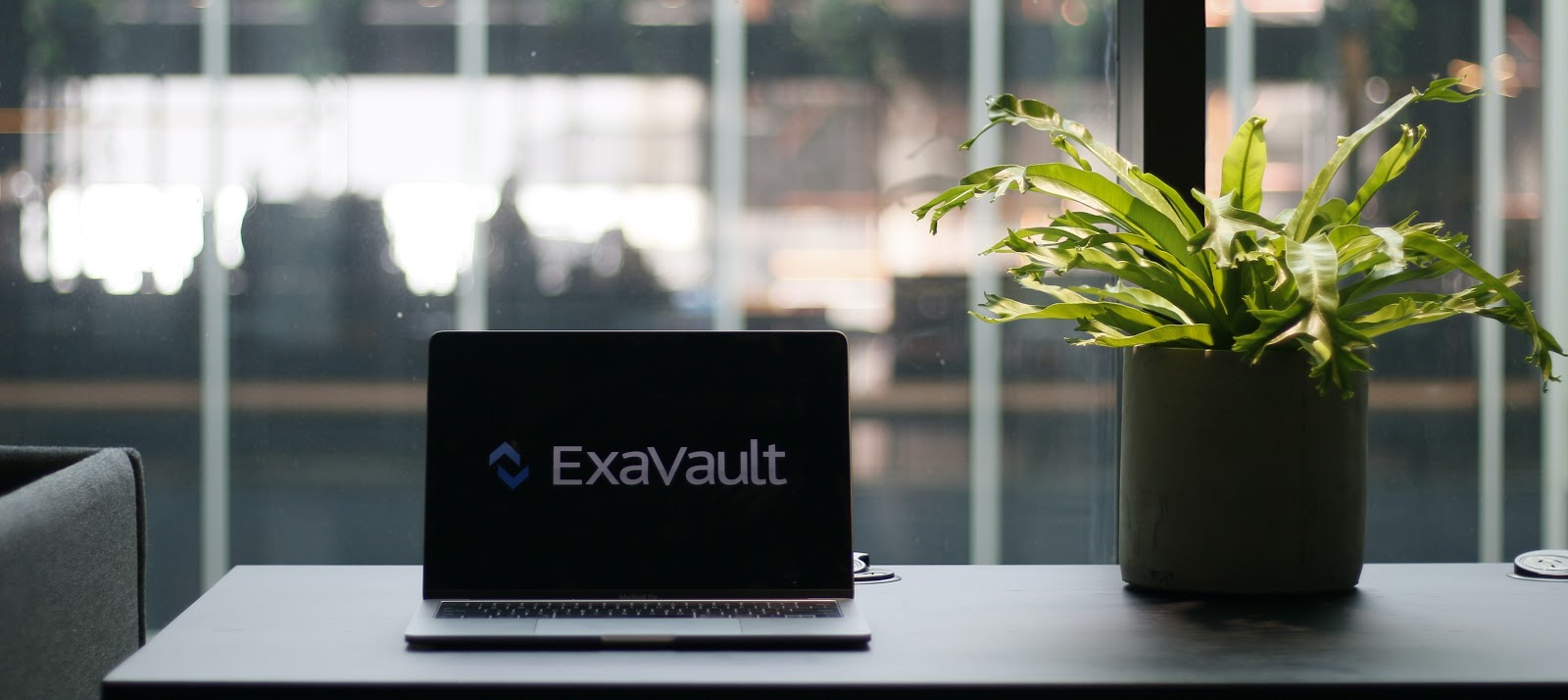 Laptop with logo for ExaVault FTP service.
