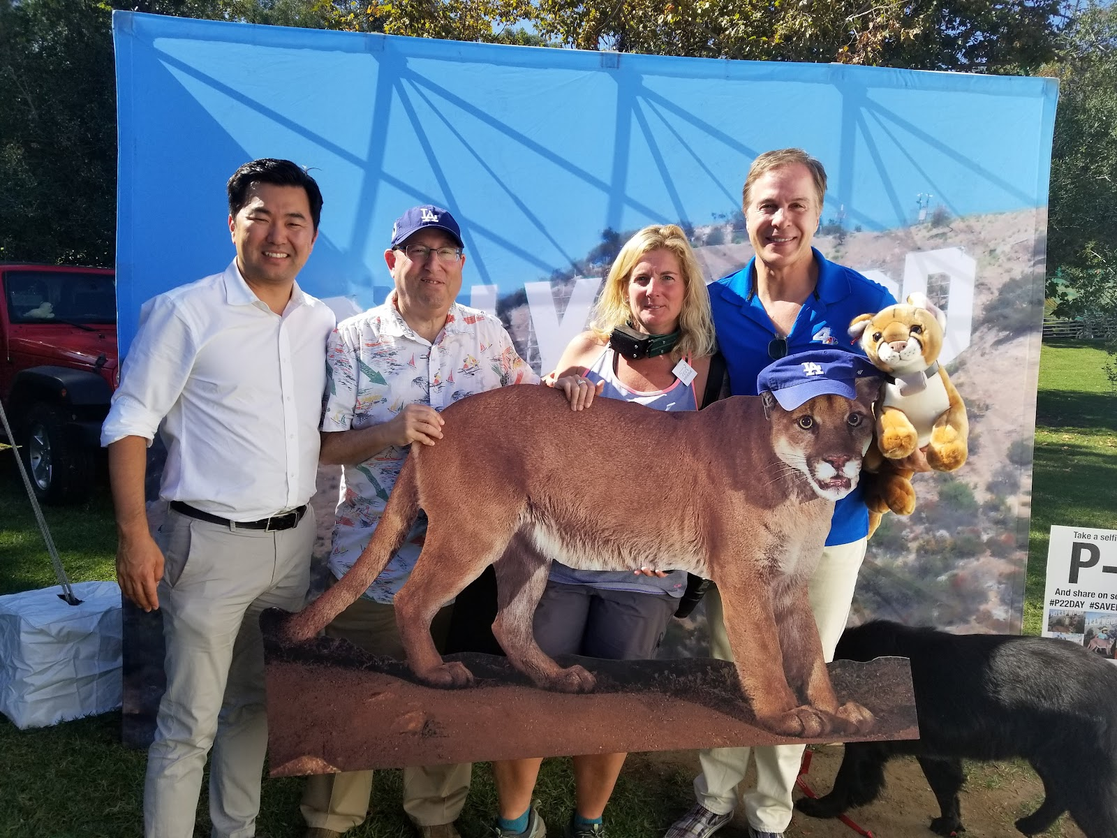 Photo of 4 people w photo of mountain lion