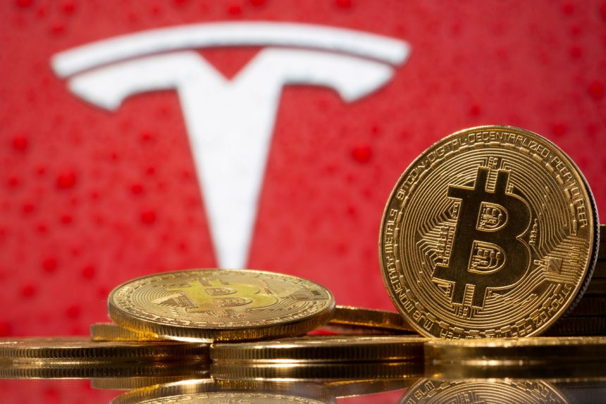 Bitcoin sinks, Tesla