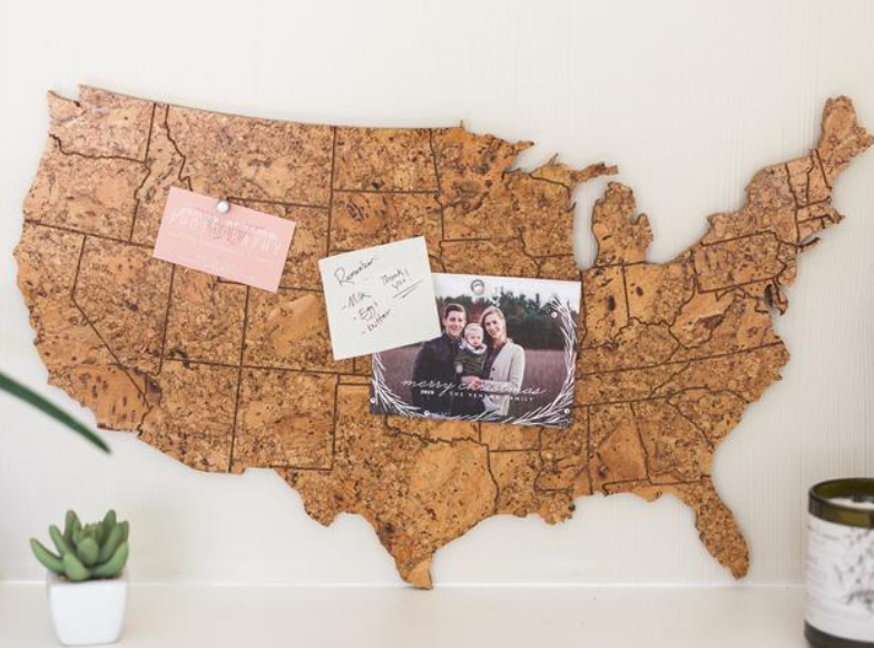 corkboard home office gift idea in shape of the United States with push pins and photos