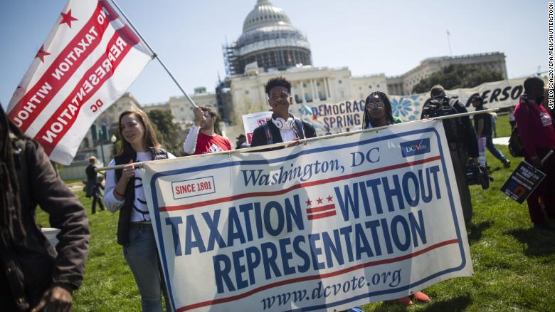 Supporters of DC statehood call for an end to 'Taxation Without Representation' as they protest outside the US Capitol in Washington in April 2016.