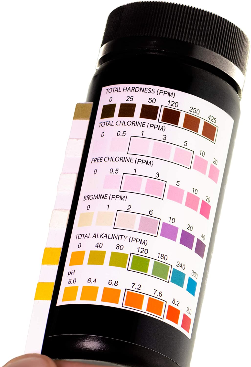 a pool chemical test strip next black bottle checking the hardness, chlorine, free chlorine, bromine, alkalinity and pH levels