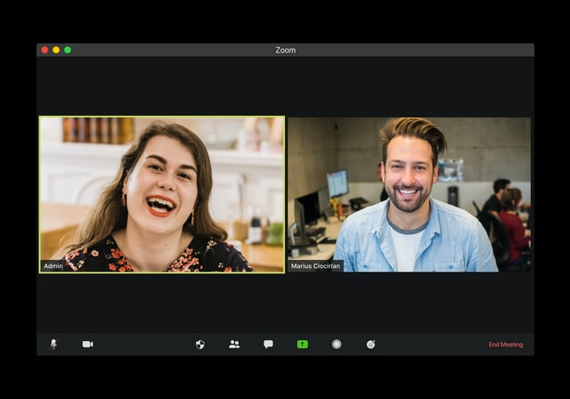 A woman and a man having a virtual video meeting