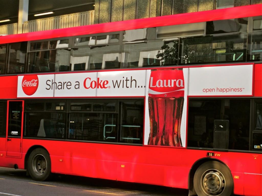 Share a Coke billboard on a double-decker bus