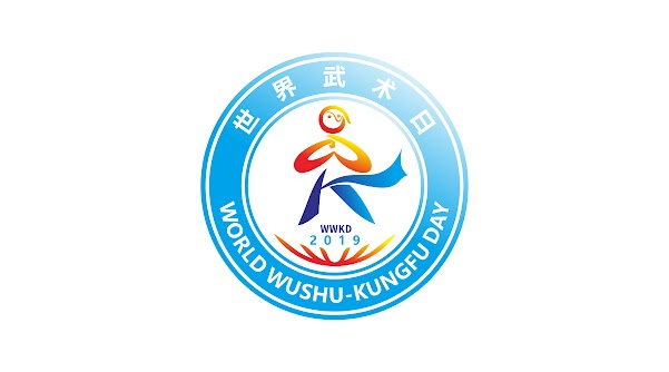 "This logo depicts a stick figure giving the ""palm-fist salute"" and calling to mind the English letters ""WK"" for the name of the holiday, ""World Wushu-Kungfu Day."" Taiji imagery appears in the figure's head,  with a ""W"" making up the ""palm-fist salute""; a ""K"" for ""kungfu"" composed of straight block graphics, calling to mind the clothing of an ancient warrior, symbolizing modern wushu's ancient and traditional origins; embedded within the figure is the essence of ""World Wushu-Kungfu Day."" The figure stands on the earth, demonstrating wushu enthusiasts' beautiful displays of wushu all over the world. The lines are both free curves and straight lines, symbolizing the perfect unity of the world's wushu, the combination of strength and flexibility, skill and strength."