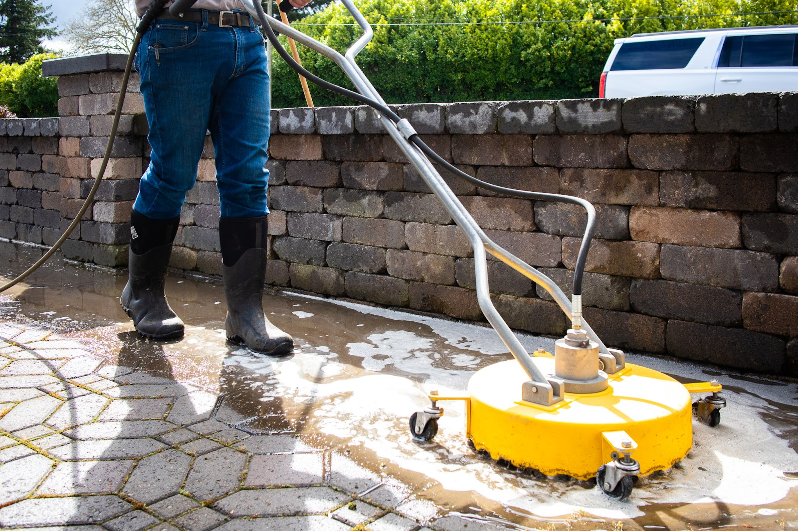 Surface cleaner washing paving stones of dirt and moss