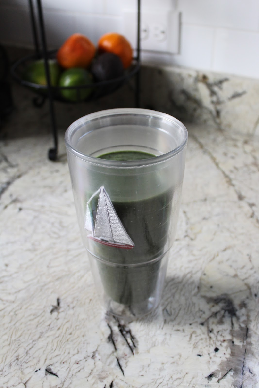 green smoothie finished in cup