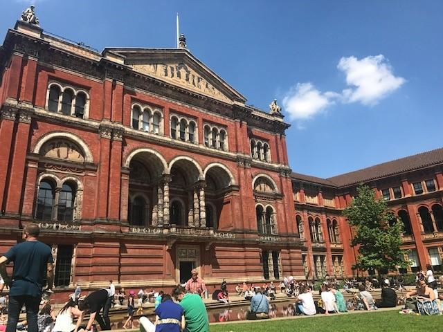 People sit in the John Madejski Garden at the Victoria and Albert Museum, a free museum in London.