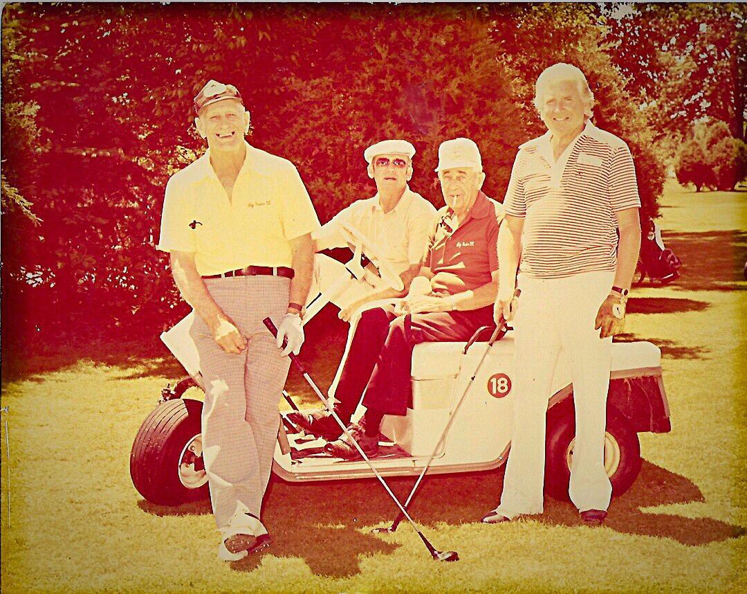 Macintosh HD:Users:BCGC:Dropbox:Secretary:Pictures:Unk, Unk, Mike Wannamaker, Art Evans photo on cart.JPG