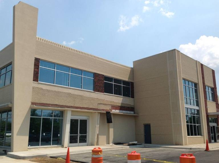 A 26,000-square-foot loft office building, shown Thursday, at 408 12th St., at the intersection of Veterans Parkway in downtown Columbus, is moving toward completion. The structure, which has been rehabilitated at a cost of $3.1 million, is the former home of Strickland Motors years ago. --