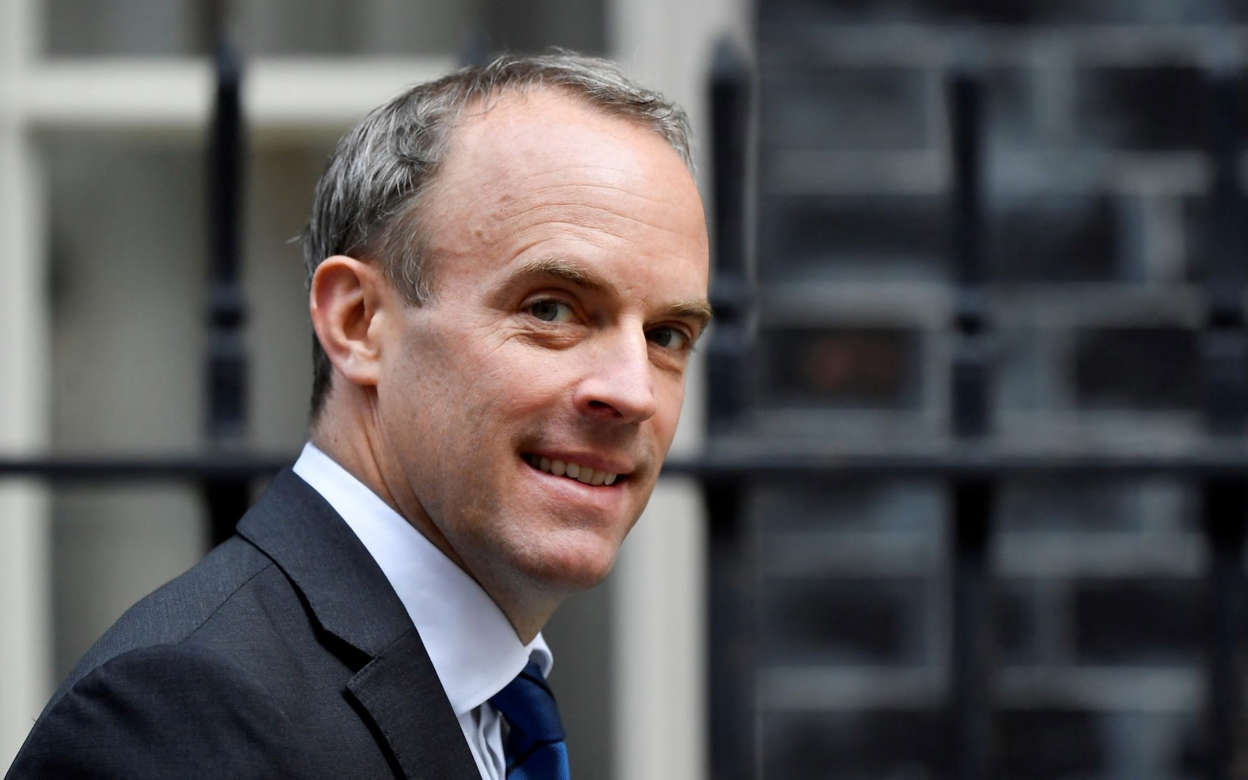 Dominic Raab wearing a suit and tie: Dominic Raab - Reuters