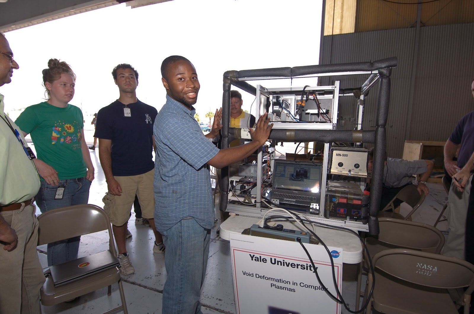 A group of students, centering Dr. Mosby, displaying their experimental setup.
