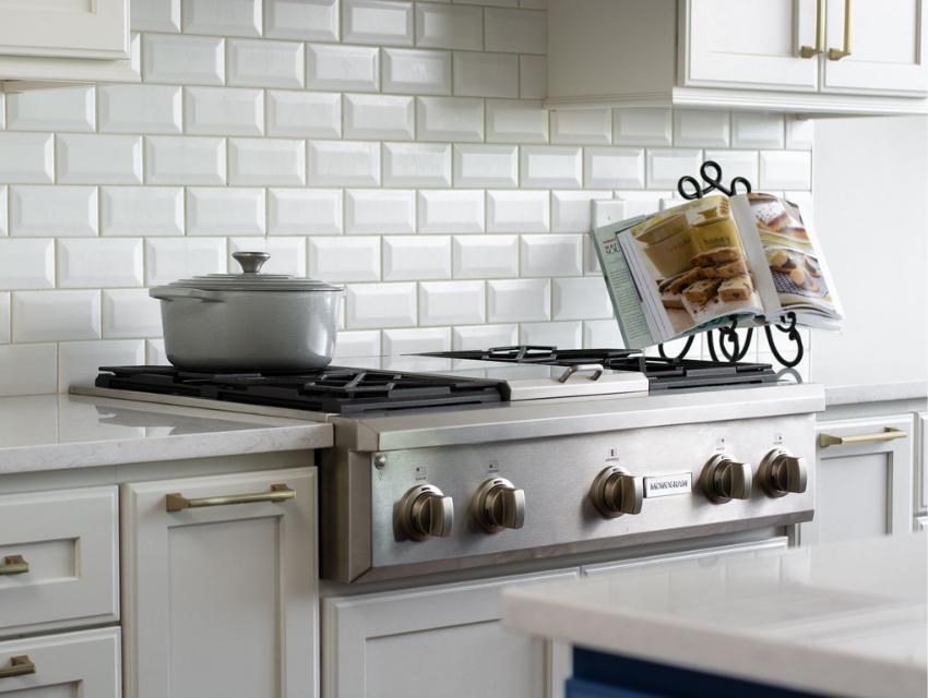 superior construction and design mt juliet general contractor cost gas range stove with cookbook- white stone countertops and beveled white subway tile backspalsh