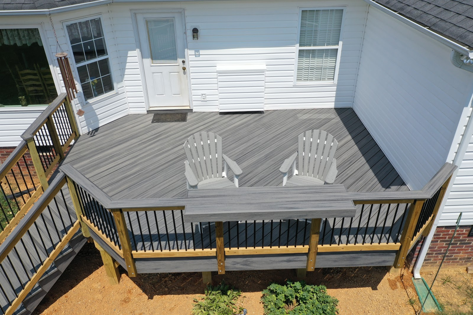 exterior overview of outdoor grey stone deck