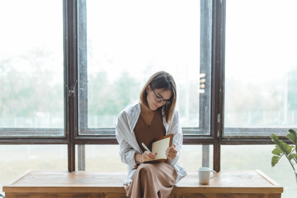 woman reflecting journaling
