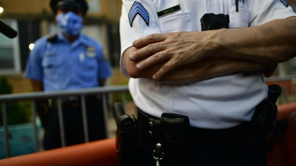 PHILADELPHIA, PA - JUNE 03: A police officer crosses his arms while observing activists gathering in protest outside the 26th Precinct on June 3, 2020 in Philadelphia, Pennsylvania. Protests continue to erupt in cities throughout the country over George Floyd, the black man who died while in police custody in Minneapolis on May 25. (Photo by Mark Makela/Getty Images)