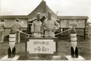 Walter Rogers on the right behind 21st Regiment sign