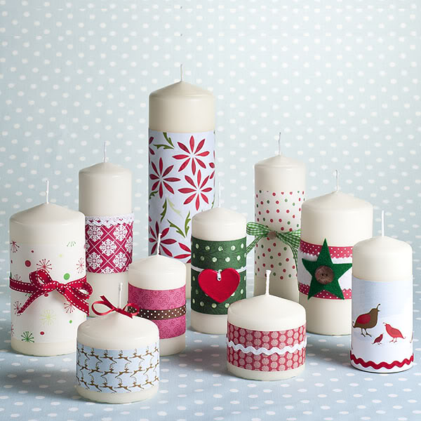 Christmas decorative paper on white pillar candles